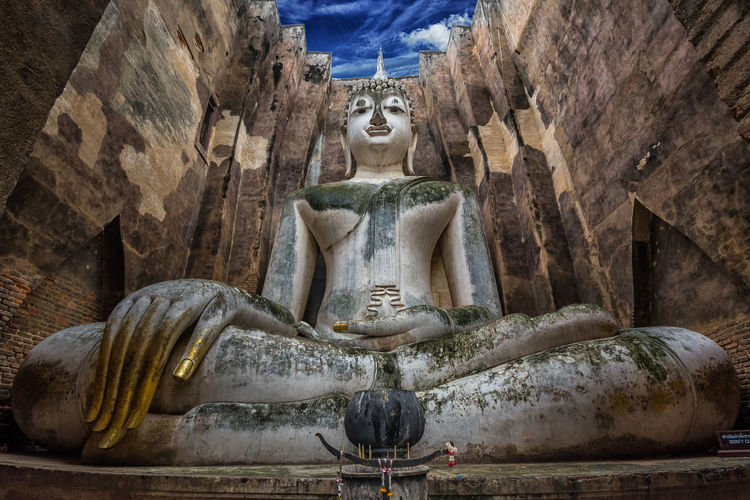 Low Angle View Of Buddha Statue