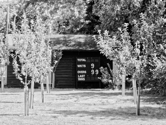 Summertime in Avebury Wiltshire and the Cricket season is in full swing! Cricket Field Summertime Black And White Blackandwhite Bnw_collection Bnwphotography Building Building Exterior Built Structure Cricket Park Scoreboard Sign Summer Text