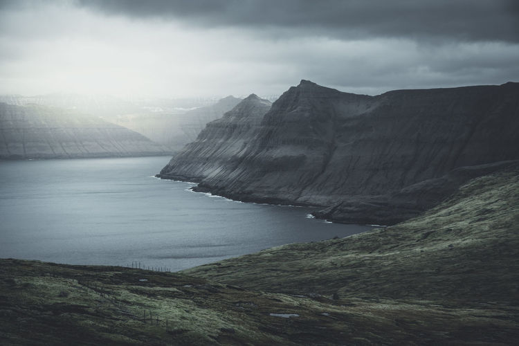 Faroe mood. Location: Faroe Islands Equipment: Fujifilm X-T2 + XF14 F2.8 R Atlantic Faeroes Faroes Moon Wanderlust Beauty In Nature Day Faroe Faroe Islands Färöer Globetrotter Landscape Moody Mountain Mountains Nature No People Outdoors River Scenics Sky Tranquil Scene Tranquility Travel Destinations Water Lost In The Landscape