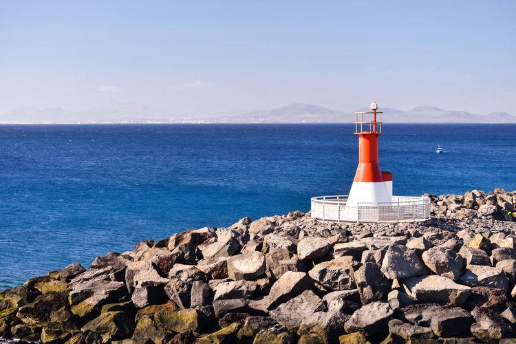 EyeEmNewHere Lanzarote Lanzarote Island Blue Day Lighthouse No People Rocks Sea Sky Water