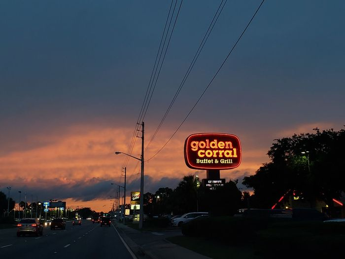 beautiful sky Golden Corral City Road Sign Illuminated Sunset Nightlife Road Communication Car Dramatic Sky Sky First Eyeem Photo