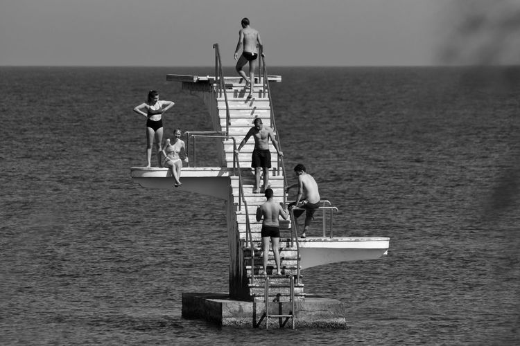Friendship Friends Friendship Real People People Blackandwhite B&w EyeEm Best Shots EyeEm Gallery Eye4photography  Real Life Summer Summertime Sea And Sky Capture The Moment Diving Summer Views Sunny Day Island Islandlife Learn & Shoot: Leading Lines Geometry Greece Greek Islands Water Men Sea Full Length Standing Togetherness Sky