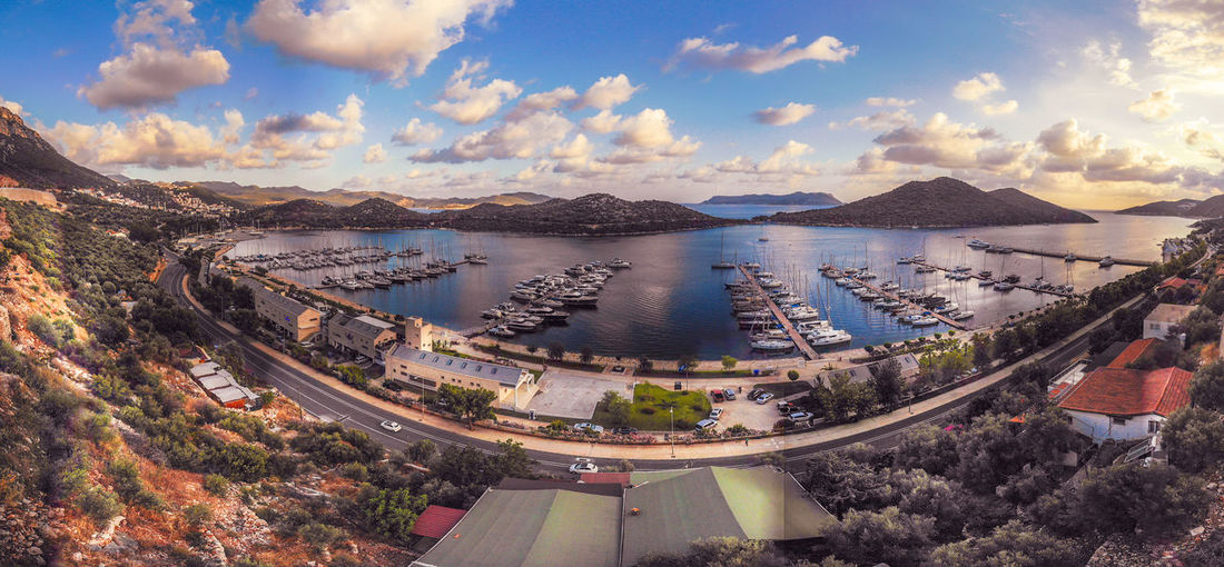 Aerial view of marina with lots of yachts. Water Cloud - Sky Sky Architecture Mountain High Angle View Nature Built Structure Transportation No People Day Scenics - Nature City Tranquil Scene Tree Beauty In Nature Tranquility Road Sea Outdoors Cityscape Drone  Aerial View Marina Yacht Ship Boat