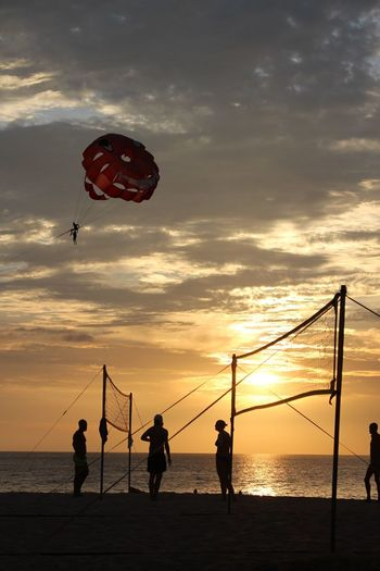 Enjoying Life Object Abstract Flying Parasailing Vacation Tourist Tourism Summer Holiday Sunset Sea Nature Water Lifestyles Beach Sky Silhouette Cloud - Sky Leisure Activity Beauty In Nature Horizon Over Water Net - Sports Equipment Beach Volleyball Sport Enjoyment Outdoors