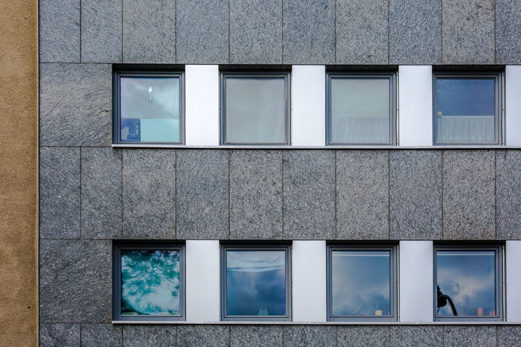 Architecture Building Building Exterior Built Structure City Day Flat Screen Full Frame Glass - Material In A Row Modern No People Outdoors Rectangle Reflection Shape Side By Side Technology Television Set Wall - Building Feature Window