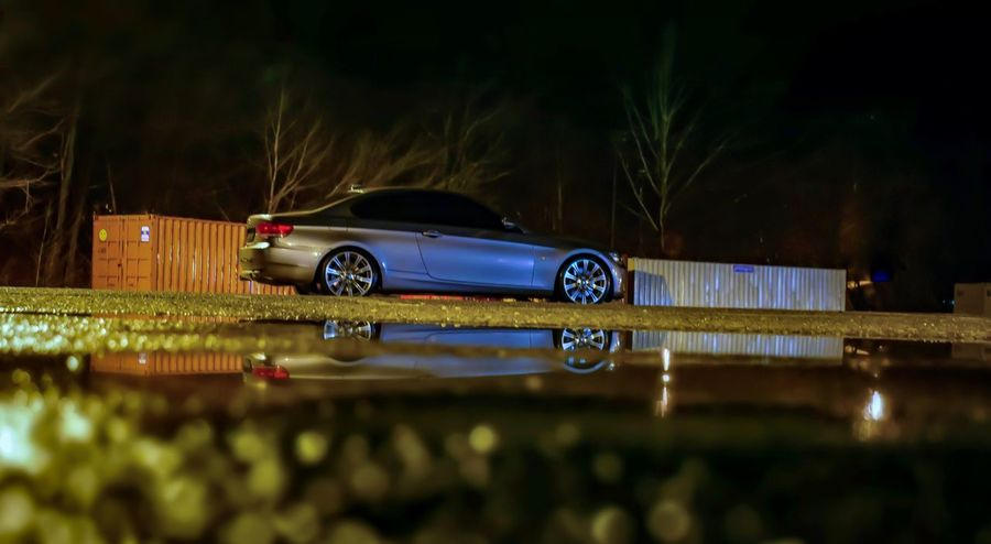 Just made bail now I'm pissed. Mask on. Bmwm3 M3 Sportscar Twinturbo E92 335i Bimmer Bmw Water Illuminated Night Reflection Wet First Eyeem Photo