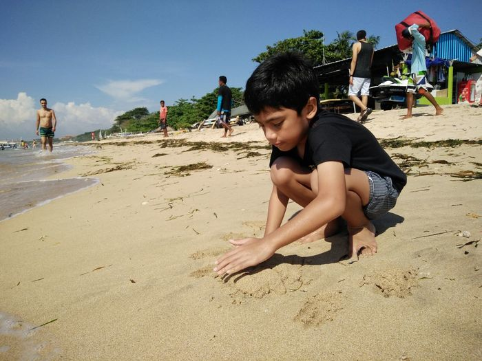 Beach Casual Clothing Day Enjoyment Full Length Leisure Activity Lifestyles Outdoors Relaxation Sand Shore Sky Summer Sunlight Sunny Vacations Tanjungbenoa Bali, Indonesia Nusadua