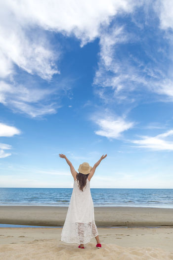 Freedom go Beach Sea Cloud - Sky Sky Land Water Human Arm One Person Arms Raised Horizon Over Water Limb Adult Horizon Women Nature Sand Standing Leisure Activity Day Body Part