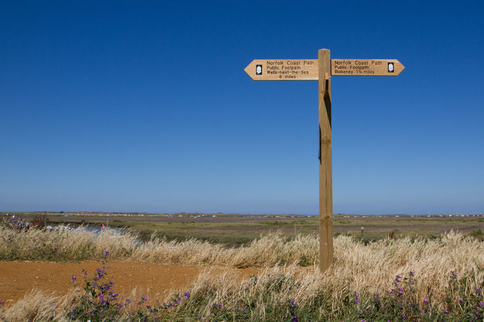Blakeney Blue Sky Clear Sky Communication Direction Field Footpath Sign Guidance Landscape Norfolk Coast Path Norfolk Costal Path Outdoors Sand Dune Sign Wells-next-the-Sea Blakeney National Nature Reserve Blakeney Norfolk Uk Wooden Sign Post