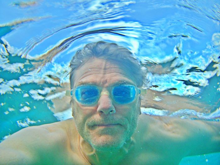 Portrait Headshot Swimming One Person Water Looking At Camera Real People Lifestyles Leisure Activity Swimwear Shirtless Eyewear Human Face Front View Diving Underwater