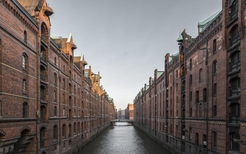 Speicherstadt, Warehouse District in Hamburg Speicherstadt Canal River vanishing point Architecture Building Exterior Built Structure Building Sky Travel Destinations Diminishing Perspective No People Outdoors Day Nobody Famous Place Landmark UNESCO World Heritage Site Narrow Water