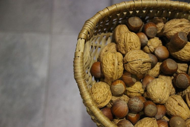 Close-up of nuts in wicker basket at home