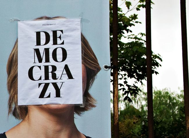 Catalunya Democracy Poster Close-up Communication Day Defaced Human Body Part Human Hand One Person Outdoors People Real People Spanish Democracy Tree