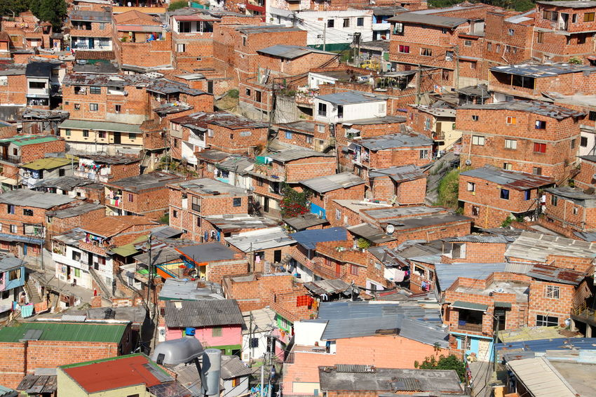 Medellín Shanty Town Apartment Architecture Building Building Exterior Built Structure City Cityscape Community Comuna 13 Crowd Crowded Day Full Frame High Angle View House Incidental People Old Outdoors Residential District Roof Town TOWNSCAPE Travel Destinations