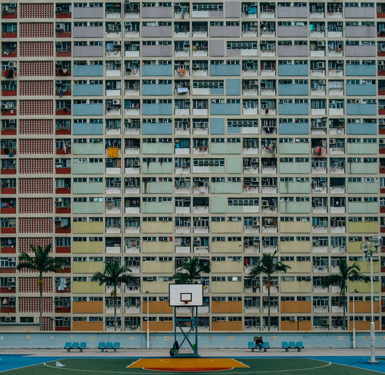 Basketball Court Against Residential Building