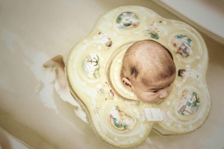 EyeEm Selects Baby Indoors  Newborn Babyhood Swimming Bathtub Neckswimmingring Happy Yellowswimring