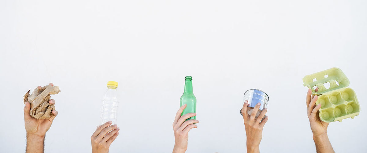 Hands up with objects Care Egg Crate Green Hands Objects Rubbish Bottle Cup Day Ecologically Environment Friendship Glassbottle Holding Human Hands Paper People Plastic Reusable Teamwork Together Togetherness Up Waste
