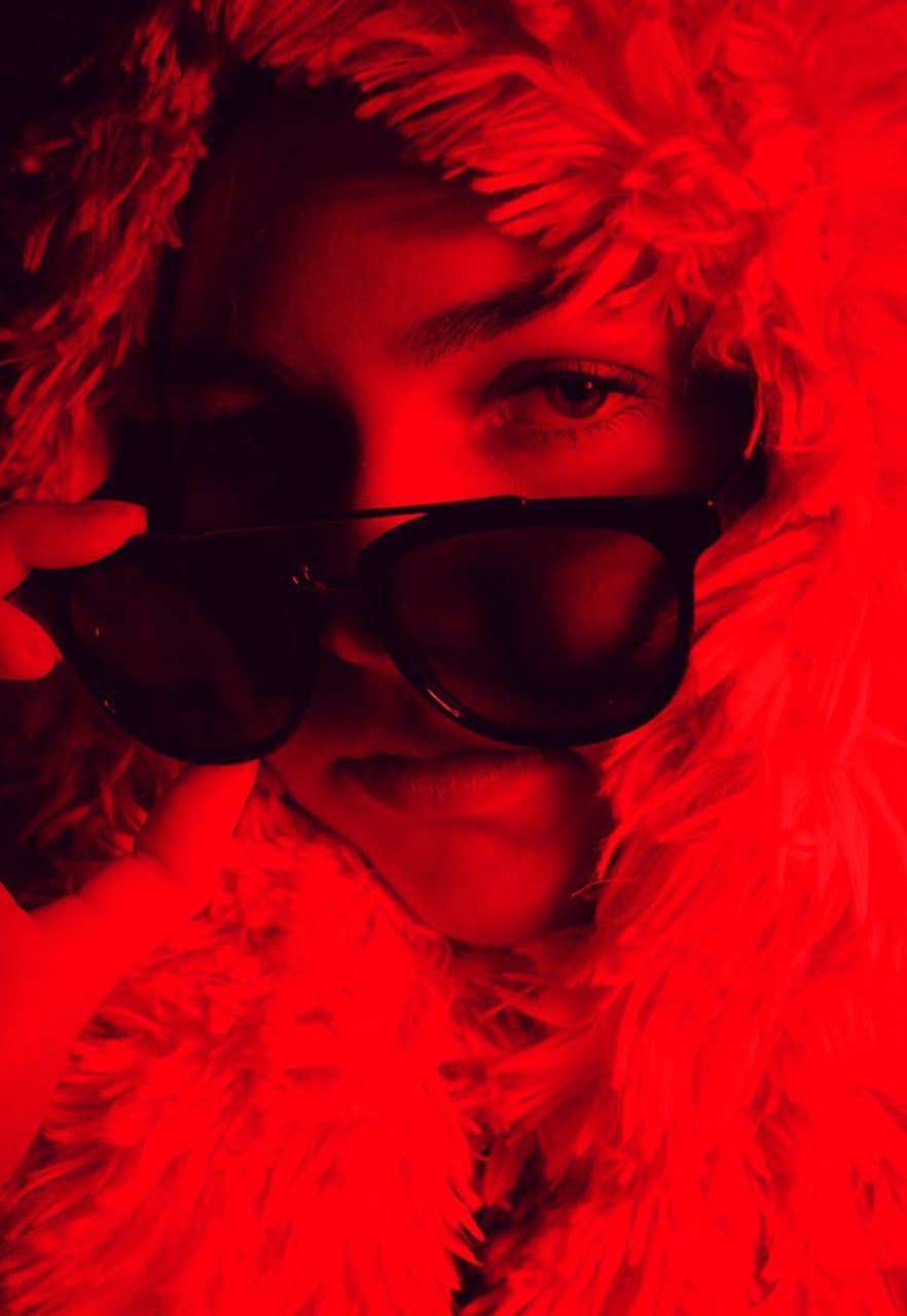 sunglasses, real people, red, one person, young adult, lifestyles, leisure activity, young women, human face, indoors, portrait, close-up, day, people