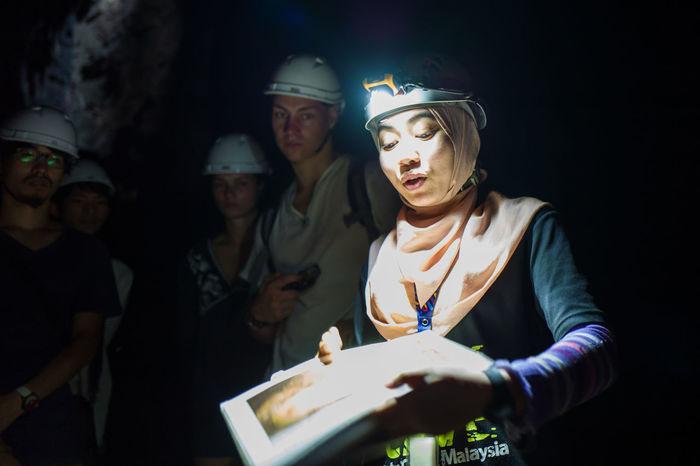 Kuala Lumpur Batu Caves Close-up Darkcave Guide Helmet Illuminated Indoors  Men Night People Real People Standing Women Young Adult Young Women