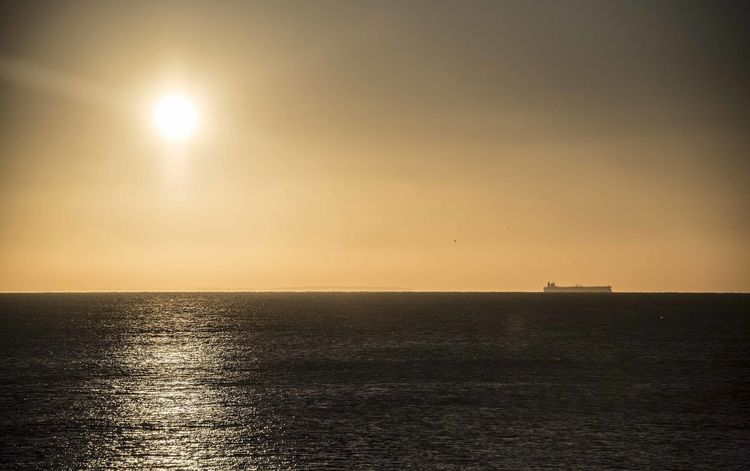 A cargo ship in the English Channel outside Folkestone, Kent Beauty In Nature Clear Sky Day Horizon Over Water Idyllic Nature No People Outdoors Scenics Sea Sky Sun Sunset Tranquil Scene Tranquility Water Waterfront
