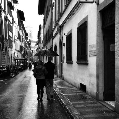 Walk in the rain Rain Couple - Relationship Travelgram Travel Destinations Travel Photography Traveling Travel Lifestyles Streetphotography Black And White Blackandwhite Florance Italy Clay Hayner Photo Street Full Length Walking Wet Two People Real People City Rear View