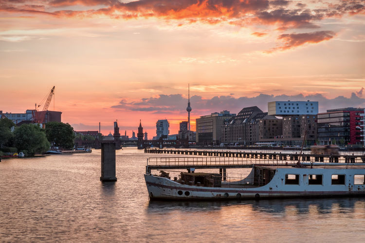 The river Spree and the skyline of Berlin, Germany, just after sunset Berlin East Riverside Skyline Spree Travel Architecture Built Structure City Cityscape Cloud - Sky Germany Nautical Vessel No People Orange Color Outdoors River Sky Sunset Tourism Travel Destinations Treptow Urban Water Waterfront
