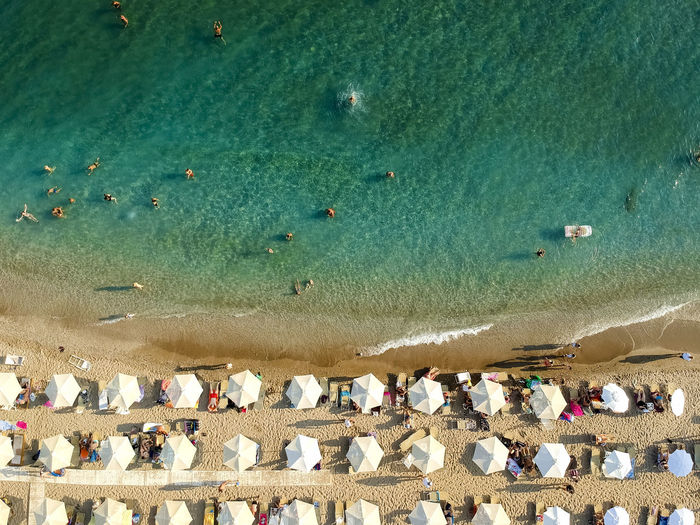 Sea Beach Water Nature Seaside Vacation Outdoors Greece Aerial View Seascape Sand And Sea High Angle View Beach Life Sea Side Sunbathing Watersports Family Time Days Off Beaching Umbrella Côte D'Azur Azure Water Azureblue Sea Waves Leisure Activity