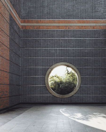 Circular Window On Brick Wall