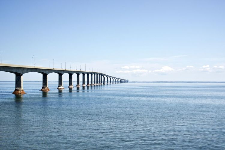 Canada: Confederation Bridge seen from New Brunswick side Confederation Bridge Daytime New Brunswick Road Architectural Column Architecture Beauty In Nature Bridge Bridge - Man Made Structure Built Structure Communication Connection Copy Space Day Daylight Engineering Horizon Horizon Over Water Majestic Nature No People Outdoors Prince Edward Island Repetition Scenics - Nature Sea Sky Tranquil Scene Tranquility Water Waterfront