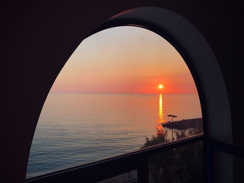 In Front Of Sicily Sea Sunset Water Horizon Over Water Orange Color Scenics Beauty In Nature Nature Tranquil Scene Tranquility No People Sky Sun Built Structure Nautical Vessel Outdoors Architecture Day Windows Window View From The Top View From The Window... Viewpoint Sunset Silhouettes