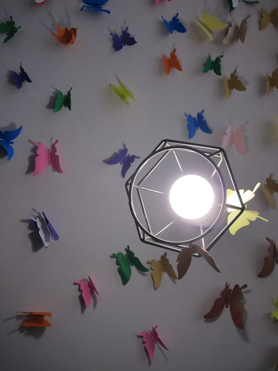 High angle view of illuminated light painting on wall