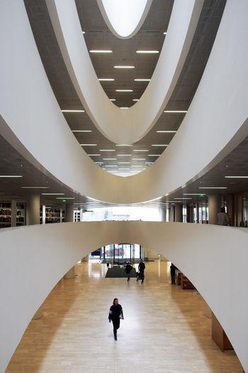 Woman walking in corridor of modern building