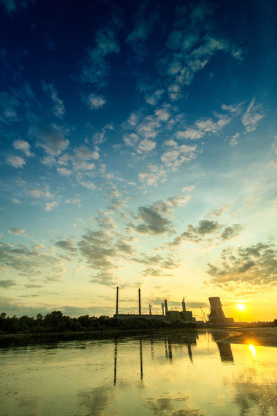 Power Stations Beauty In Nature Blue Calm Cloud Cloud - Sky Cloudy Dramatic Sky Idyllic Nature No People Non-urban Scene Orange Color Outdoors Reflection Remote Scenics Sky Sun Sunset Tranquil Scene Tranquility Water