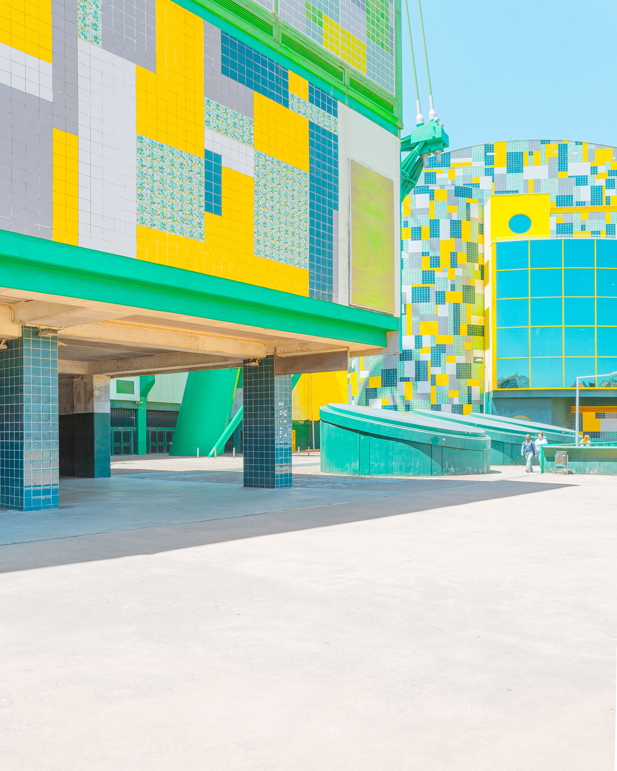 architecture, built structure, building exterior, no people, day, multi colored, building, city, outdoors, nature, sunlight, yellow, empty, sky, clear sky, absence, in a row, business, street, transportation