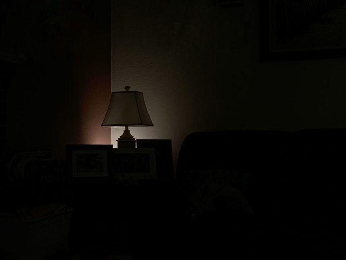 Illuminated lamp post on sofa at home