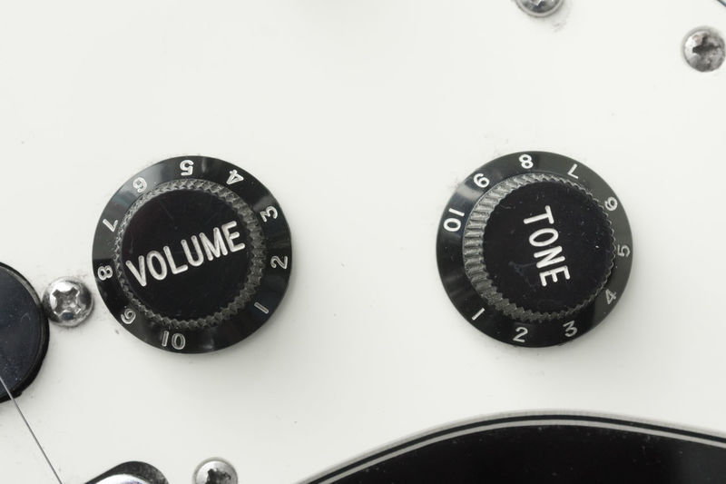 Picture of the volume and tone controls of a Fender Stratocaster for the OO mission. Black & White Black And White Black&white Blackandwhite Close-up Contrast Dirty Dust Guitar Loud Macro Minimalism Minimlism Monochromatic Monochrome Number The OO Mission