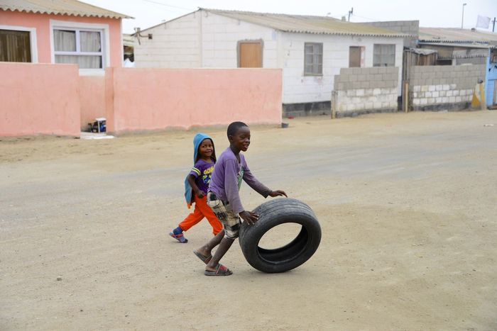 Playing boys in the Township of Swakopmund Children Namibia Swakopmund Township Life Africa Boy Boys Hapiness Playful Playing Township Tyre