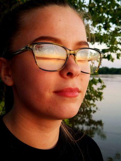 Close-Up Of Woman Wearing Eyeglasses Looking Away