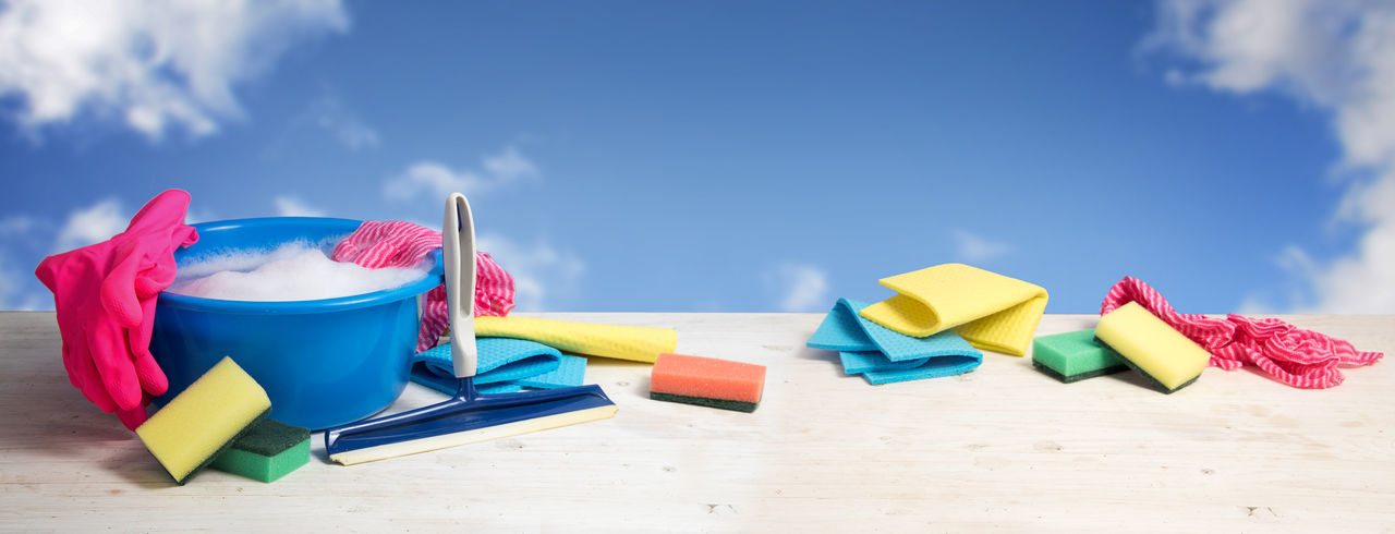Cleaning Equipment On Table Against Sky