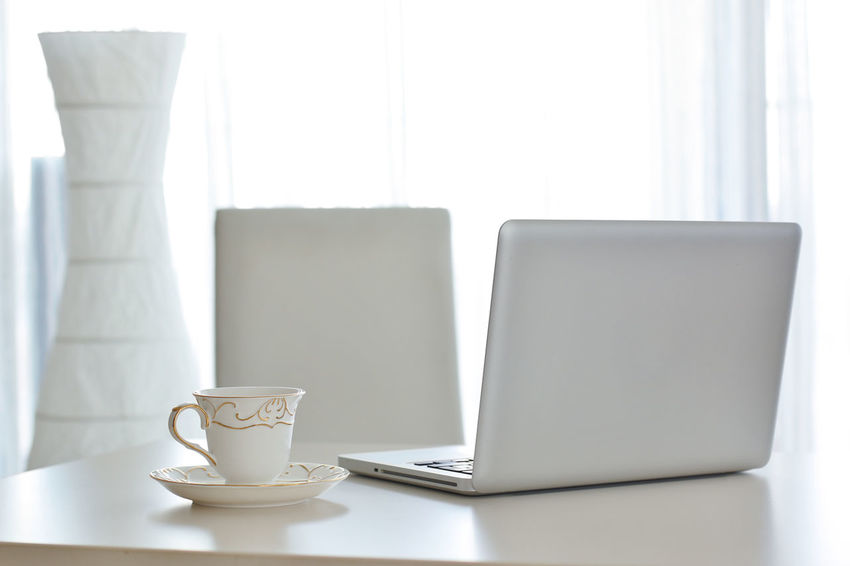 Close-up Coffee - Drink Coffee Cup Computer Cup Day Indoors  No People Table Technology White Color Wireless Technology Workplace