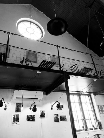 A café in the old pumphouse in Karlskoga Sweden. Hanging Low Angle View Lighting Equipment Architecture Built Structure Indoors  Ceiling Window Pendant Light Day Real People Illuminated Electricity  Fan Sunlight Group Building Decoration Light Clock Electric Lamp Black And White Photography Black And White Coffee Time Coffee Table Cafe Time Cafe Upstairsview Upstairs Photos On The Wall High Roof