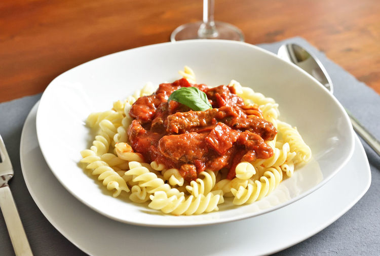 Goulash dish on a white plate, gourmet food. Dish Pasta Dish Tomato Sauce Dinner Eating Utensil Food Food And Drink Freshness Fussili Garnish Goulash Goulash Pot Gourmet Healthy Eating Hungarian Culture Indoors  Italian Food Meal No People Pasta Plate Ready-to-eat Serving Size Still Life Table