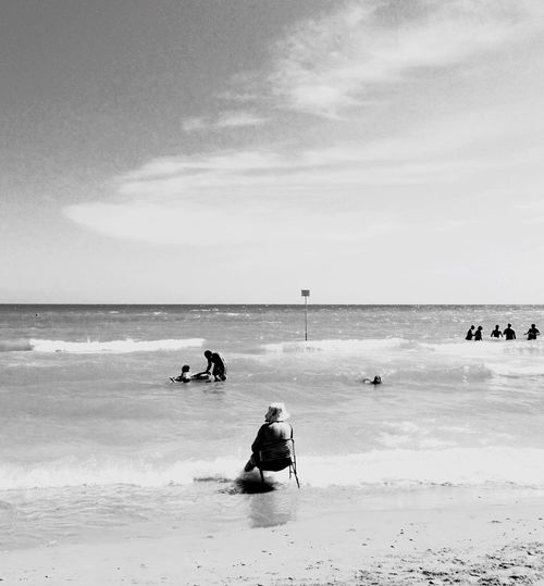 re-lax Blackandwhite Sea Beach Water Land Horizon Over Water Sky Horizon Real People Group Of People Leisure Activity Sand Vacations Lifestyles Holiday