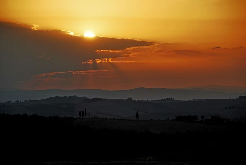 Montalcino. Beauty In Nature Idyllic Landscape Mountain Nature No People Orange Color Outdoors Scenics Silhouette Sky Sun Sunlight Sunset Tranquil Scene Tranquility Tree