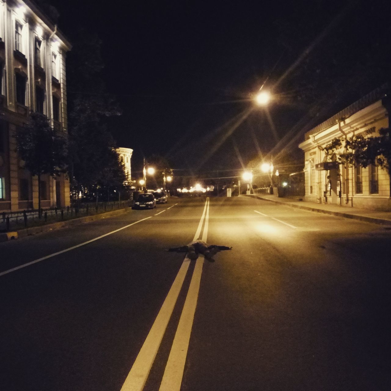 illuminated, night, architecture, building exterior, built structure, road, transportation, the way forward, street light, street, outdoors, no people, city, sky