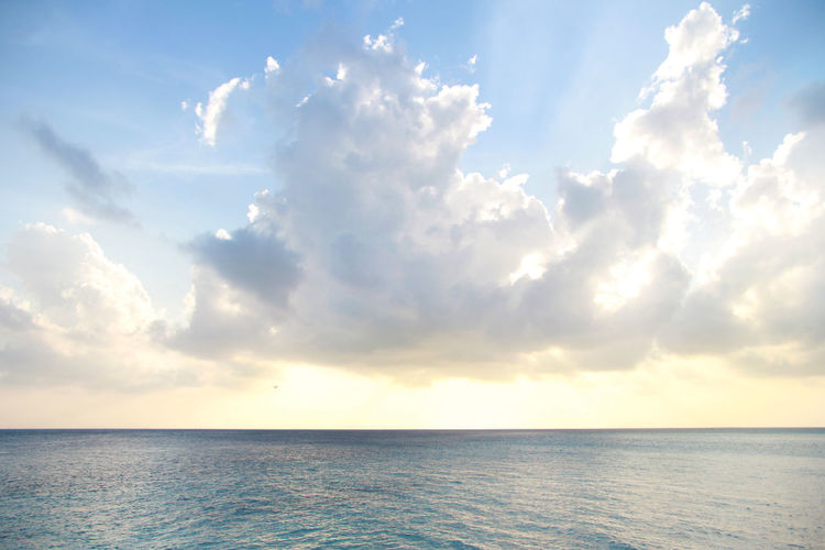 Sky Water Sea Cloud - Sky Scenics - Nature Sunshine Sunlight Sun Behind Clouds Bright Blue Blue Sky Ocean Horizon Over Water Beauty In Nature Horizon Tranquility Tranquil Scene Nature No People Day Outdoors