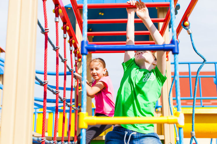 Children playing on slide at playground