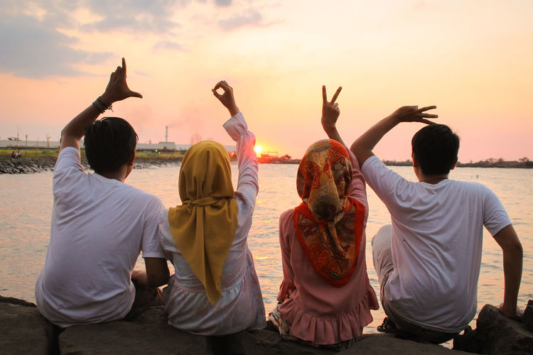 Friendship EyeEm Selects Group Of People Water Sky Friendship Togetherness Rear View Adult Women Sunset Medium Group Of People Nature Young Adult Emotion Holiday Group People Fun Sitting Outdoors Trip