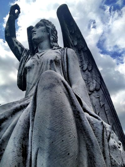 Low angle view of statue against cloudy sky