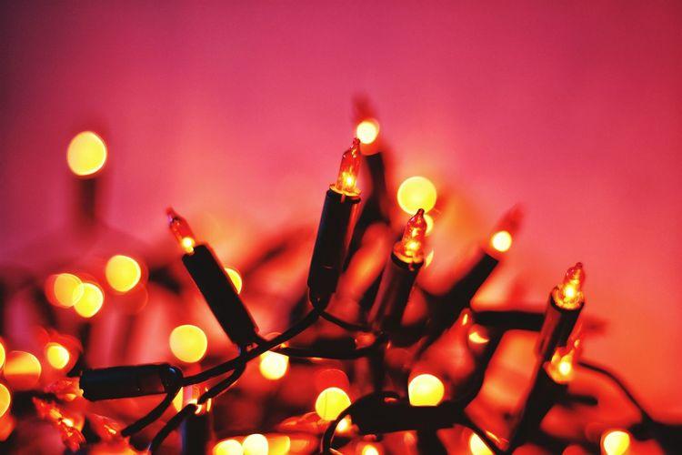 Close-Up Of Illuminated Lighting Equipment At Night
